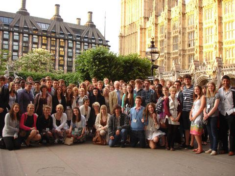 Peter outside Parliament with young people